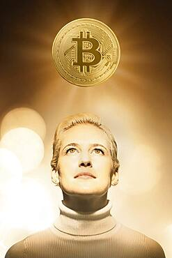 Woman with bitcoin over head