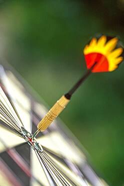 Dart arrow in target center of dartboard