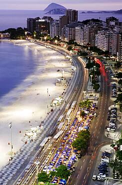 Brazil, Rio de Janeiro, Copacabana Avenida Atlantica and Copacabana Beach at night