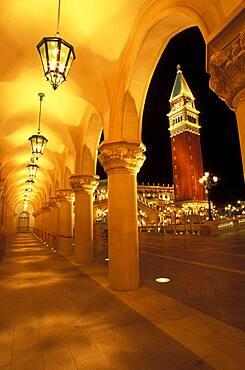 Italy, Venice, Veneto, San Marco Campanile seen from arcade at night