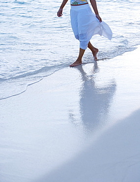 Woman strolling the beach