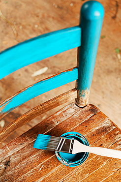Old wooden chair with turquoise paint