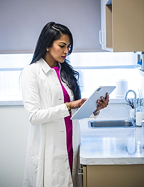 Female doctor with medical documents
