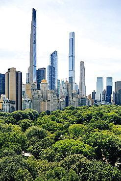 USA, New York, New York City, Skyscrapers near public park