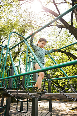 USA, New York, New York City, Girl walking on footbridge on playground