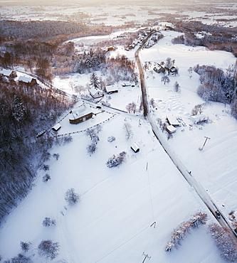 Poland, Subcarpathia, Odrzykon, Aerial view of village in winter