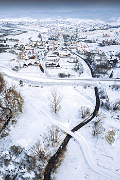 Poland, Lesser Poland, Pieniny National Park, Aerial view of winter landscape with village in Pieniny National Park