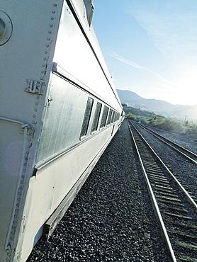 Close-up of passenger train crossing landscape
