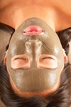 Close-up of woman with facial mask