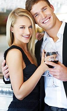 Couple drinking wine in restaurant