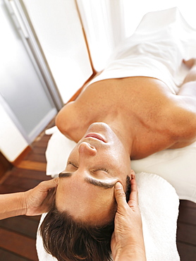 Man getting facial massage in spa