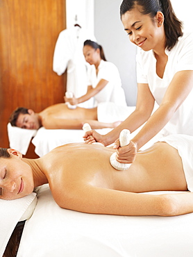 Two people getting massage in spa