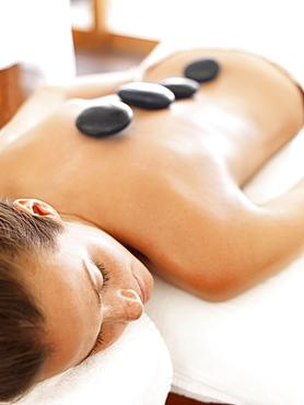 Woman getting lastone therapy in spa