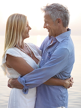 Portrait of mature couple at sunset