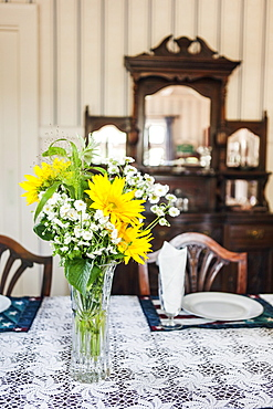Close-up of flowers in vase on table in dining room