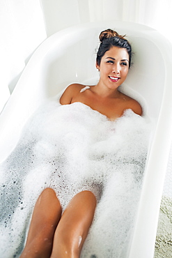 Portrait of woman in bubble bath
