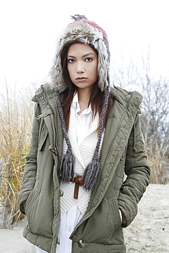 Portrait of young woman in warm clothes