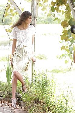 Portrait of woman in dress in garden