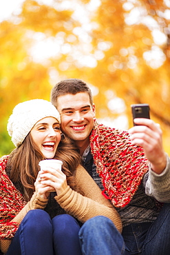 Portrait of couple in Central Park taking photo of themselves, USA, New York State, New York City