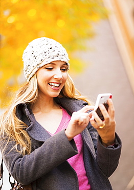 Portrait of blond woman using cell phone, USA, New York City, Brooklyn, Williamsburg