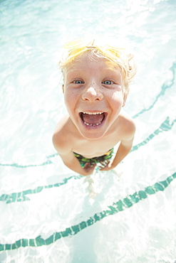 Boy (4-5) posing in swimming pool