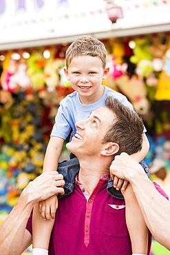 Happy father with son (4-5) in amusement park, USA, Utah, Salt Lake City