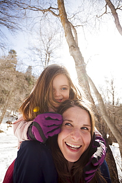 Young woman carrying her daughter (2-3) on shoulders, USA, Utah, Highland