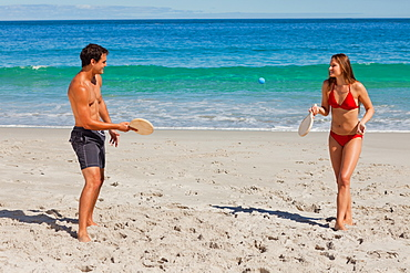 Tanned couple playing with beach racket  - 1120-1434