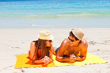 Couple being tanning while talking - 1120-1552