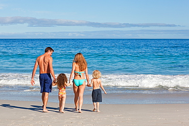 Family spending their time on the beach