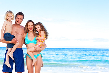 Cheerful family spending time on the beach