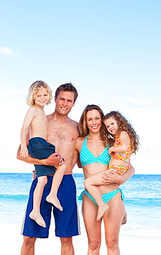 Happy family spending their day on the beach - 1120-495