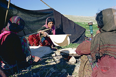 Qashqai women making bread in camp, southern area, Iran, Middle East