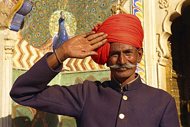 Guard in turban saluting at City Palace, Jaipur, Rajasthan state, India, Asia