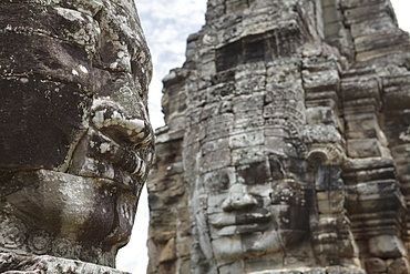 Smiling faces carved in stone, Bayon, Angkor, UNESCO World Heritage Site, Siem Reap, Cambodia, Indochina, Southeast Asia, Asia