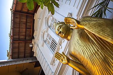 Golden statue at the entrance of Gangaramaya Temple, Colombo, Sri Lanka, Asia