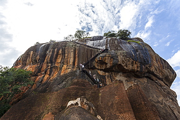 Tourists ascending Sigiriya (Lion Rock), UNESCO World Heritage Site, Sri Lanka, Asia