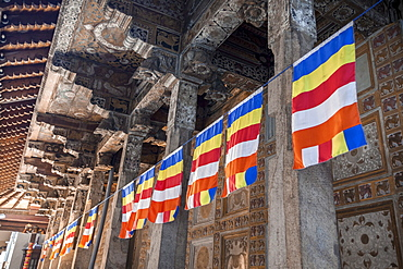 Colourful Buddhist flags adorning columns, Temple of the Sacred Tooth Relic, UNESCO World Heritage Site, Kandy, Sri Lanka, Asia