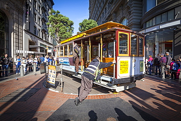 Powell-Hyde Cable Car being turned by brakemen, San Francisco, California, United States of America, North America