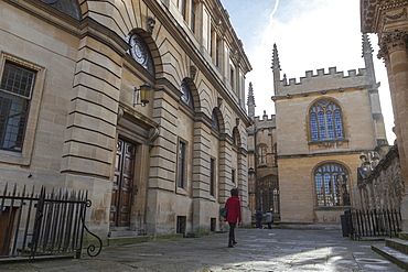 Wandering past the Sheldonian Theatre towards the Bodleian Library, Oxford, Oxfordshire, England, United Kingdom, Europe