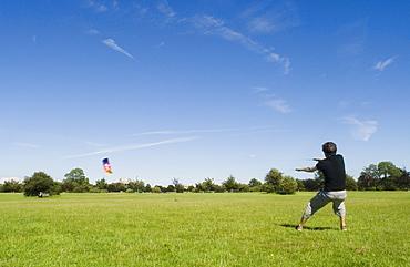 Man flying power kite on the Downs, Bristol, UK
