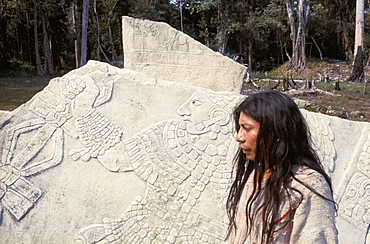Lacandon Indian from Bonampak in front of Mayan stele, Mexico, North America
