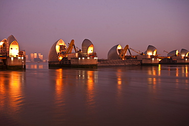 Thames Barrier and Canary Wharf at dawn, London, England, United Kingdom, Europe
