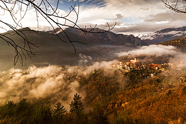 Village of La Bollene Vesubie in the evening mist in the Maritime Alps (Alpes Maritimes), France, Europe