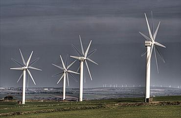 Wind turbine and setting sun, Carland Cross wind Farm nr Truro,Cornwall, uk. MORE INFO 15  Vestas turbines, built 1992, one of oldest wind farms in uk
