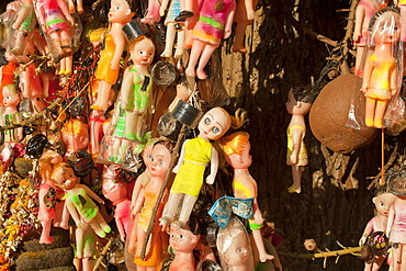 1000s of white dolls hung grotesquely on a canon ball tree for fertility, in the Janardhana swamy Hindu temple in Varkala,Kerala, India. more info: We need to question our need to reproduce more and more of us. As over population is the root of most of our problems.