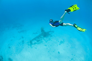 Freediver and WWII plane wreck.  Yap, Federated States of Micronesia, Pacific Ocean.  More info:  This is the tail of a Japanese bomber shot down over Yap during the summer of 1944 by U.S. planes.