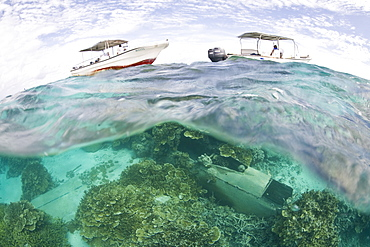 Dive boats over a Japanese plane wreck from WWII.  Yap, Federated States of Micronesia.