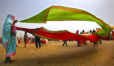 Indian women drying clothes at ǪGangasagar  fairǩ  in  Sagar Island , West Bengal , India