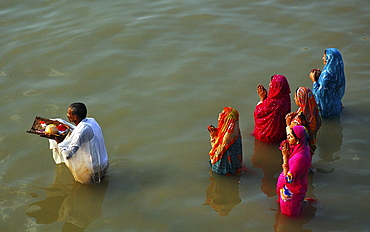 """Devotees offering prayer to sun god during """"Chat Puja"""", a religous festival celebrated by the hindus in India,  Kolkata,  India"""